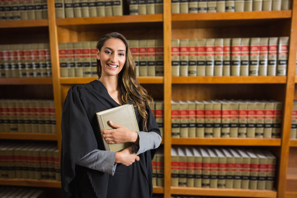 Female paralegal studying in a law library