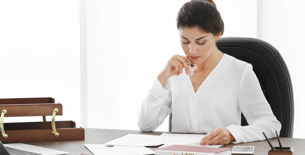 A female paralegal reviewing a legal contract